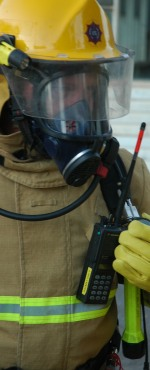 A breathing apparatus set user checking the contents of the cylinder with the gauge